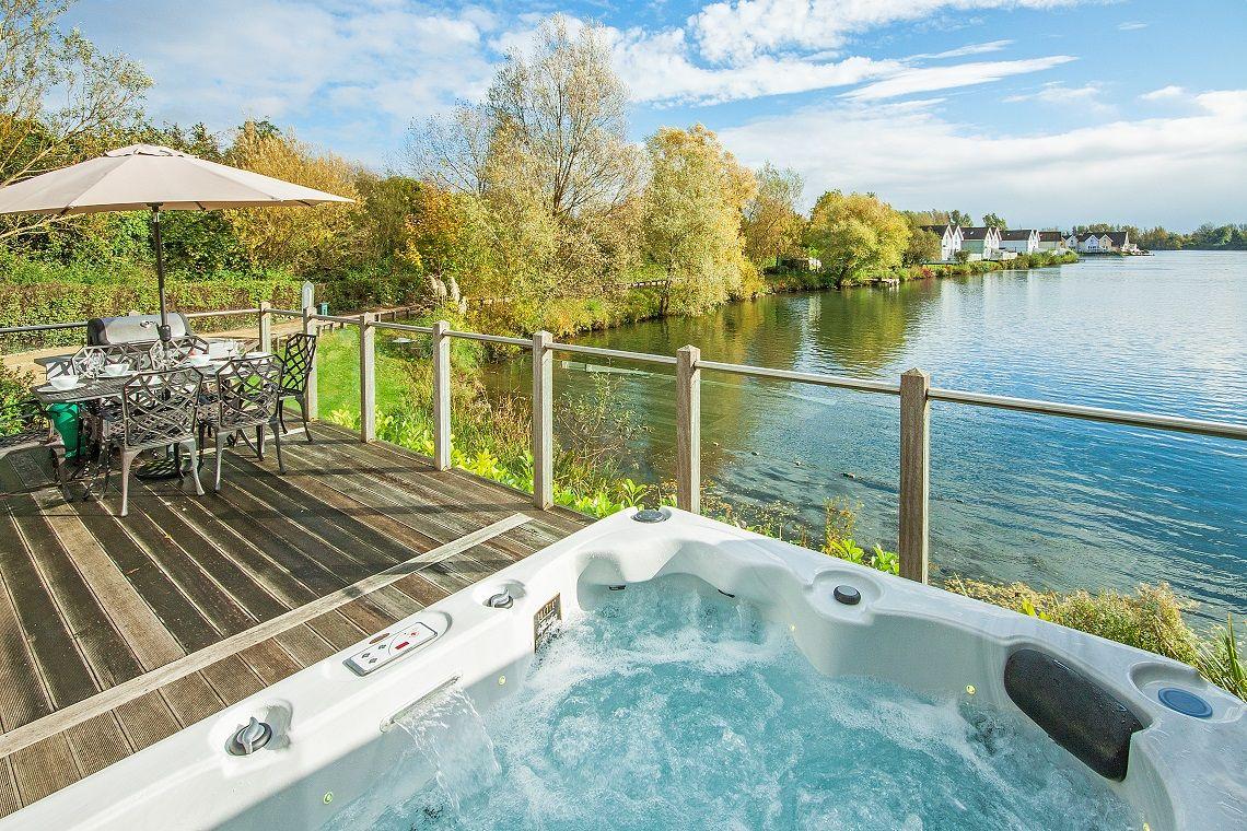 Hot tub outside of a lakeside property